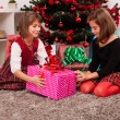 Happy kids with christmas present — Stock Photo #13980580