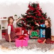 Kids with their christmas presents — Stock Photo #13980612
