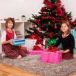 Happy kids with christmas present — Stock Photo