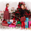 Kids with their christmas presents — Stockfoto