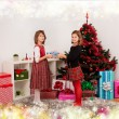 Kids with their christmas presents — Stock Photo #13980772