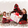 Kids with their christmas presents — Stock Photo #13980794