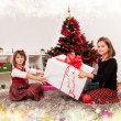 Kids with their christmas presents — Stock Photo #13980795