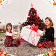 Kids with their christmas presents — Stock Photo #13980800