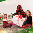 Kids with their christmas presents — Stock Photo #13980801