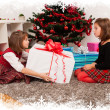Kids with their christmas presents — Stock Photo #13980820