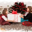 Kids with their christmas presents — Stock Photo #13980861