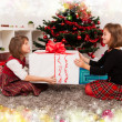 Kids with their christmas presents — Stock Photo #13980863