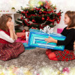 Kids with their christmas presents — Stock Photo #13980940