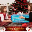 Kids with their christmas presents — Stock Photo #13980952