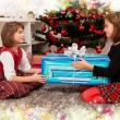 Kids with their christmas presents — Stock Photo #13980957