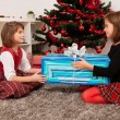 Happy kids with christmas present — Stock Photo