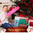 Kids with their christmas presents — Stock Photo #13981759