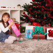Happy kids with christmas present — Stock Photo #13981827