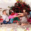 Kids with their christmas presents — Stock Photo #13981893