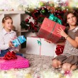 Kids with their christmas presents — Stock Photo #13981917
