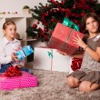 Stock Photo: Happy kids with christmas present