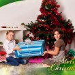 Kids with their christmas presents — Stock Photo #13981931