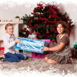 Kids with their christmas presents — Stock Photo #13981938