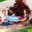 Kids with their christmas presents — Stock Photo #13981950