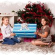 Kids with their christmas presents — Stock Photo #13981957
