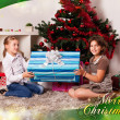 Kids with their christmas presents — Stock Photo #13981967