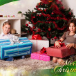 Kids with their christmas presents — Stock Photo #13982000