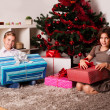 Happy kids with christmas present — Stock Photo #13982024