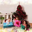 Kids with their christmas presents — Stock Photo #13982036