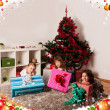 Kids with their christmas presents — Stock Photo #13982040