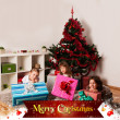 Stock Photo: Kids with their christmas presents
