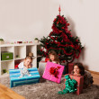 Happy kids with christmas present — Stock Photo #13982045