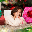 Kids with their christmas presents — Stock Photo #13982390