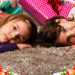 Kids with their christmas presents — Stock Photo #13982568