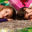 Kids with their christmas presents — Stock Photo #13982571