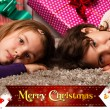 Kids with their christmas presents — Stock Photo #13982576