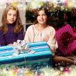 Kids with their christmas presents — Stock Photo #13982584