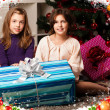 Kids with their christmas presents — Stock Photo #13982589