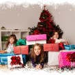 Kids with their christmas presents — Stock Photo #13982595
