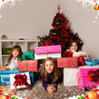 Kids with their christmas presents — Stock Photo #13982598