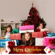 Kids with their christmas presents — Stock Photo #13982600