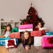 Happy kids with christmas present — Stock Photo #13982601