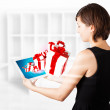Young woman looking at modern tablet with present boxes — Stockfoto #14580377