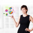 Young woman looking at modern tablet with pie charts - Foto Stock