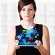 Young woman looking at modern tablet with colourful technology i — Stock Photo