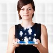 Young woman looking at modern tablet with social icons — Stock Photo #14580429