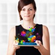 Young woman looking at modern tablet with pie charts — Stock Photo #14580433