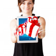 Young woman looking at modern tablet with present boxes — Stock Photo