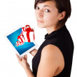 Young woman looking at modern tablet with present boxes — ストック写真