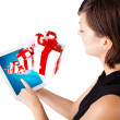Young woman looking at modern tablet with present boxes — Stock Photo #14580615